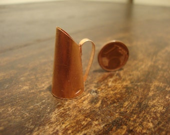 Miniature copper jug