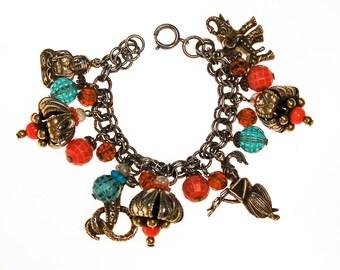 1940s Loaded Charm Bracelet, Snake Charmer, Cobra, Elephant, Moroccan Influence, Green, Orange Beads, Gold Tone, Made in Germany