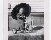 Girl On Tricycle Holding Umbrella Vintage Snapshot Mid Century Modern Children At Play Photo Of Child Antique Transportation Toy Photograph