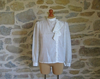 1980s white blouse with asymmetric button fastening, silver and gold metallic thread pattern, size M