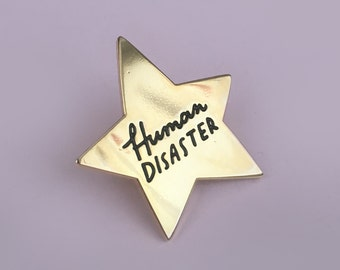 Human Disaster, gold star enamel pin