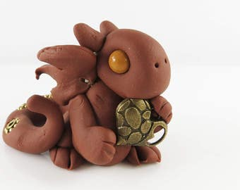 Polymer clay brown baby dragon