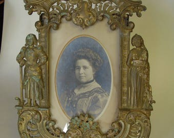 Antique photo in ornate brass frame