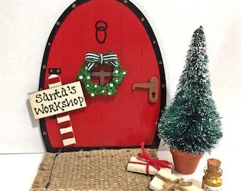 Handpainted Personalised Christmas Tree Fairy Door Set in Red Elves Pixies Skirting Board Decoration Santa's Workshop or Name with Wreath