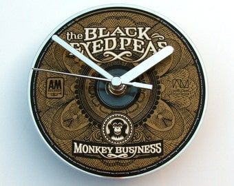 "Black Eyed Peas CD CLOCK. "" Monkey Business "" from an original music cd. Fun gift for R&B dance music fans Comes in a box black gold silver"