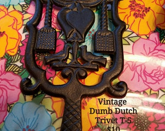 Vintage 'Dumb Dutch' Cast Iron Trivet