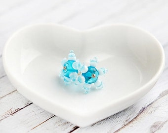 Christmas Sale - Snowflake earrings, sky blue white ear posts, artisan lampwork glass, winter stud earrings, small snowflake earrings