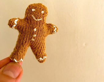 A Micro Gingerbread Guy called Gingie. Hand Knitted MADE TO ORDER