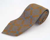 Vintage 1960s Skinny Gold and Blue Paisley Silk Tie by Don Loper