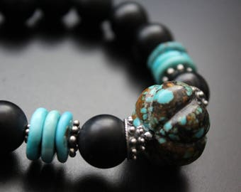 Tribal bracelet - turquoise and matte onyx bracelet - turquoise jewelry - bold statement boho bracelet - carved genuine turquoise melon bead