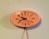 Mid Century Modern General Electric GE PINK Oval CLOCK Model 2H115 1950s