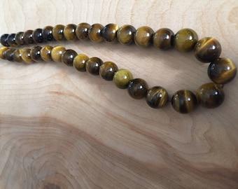 Strand of 12mm Tiger Eye Round Beads- 33 pcs.