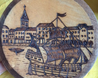 Pyrography Design Wooden Plate showing a seaside town and a sailing ship