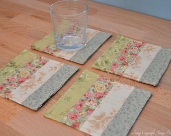 Floral fabric coasters.  Soft pastel coasters. Flower theme. Quilted drink coasters, patchwork coasters. Machine washable reversible UK