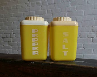 Vintage Salt and pepper yellow plastic picnic shakers mid century