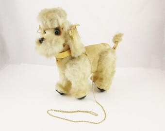 A Super Fun Fuzzy Cream-colored Stuffed Poodle - Blue Eyes and Gold Plastic Collar - Pull Her Chain and She Walks (Sorry, Not Any More)