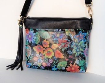 Leather crossbody in floral print.   Flowers on a dark background, leather crossbody or shoulder bag.