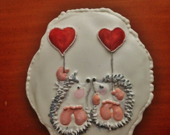 Hedgehogs in love.Hungarian gingerbread Valentine's Day Cookie.