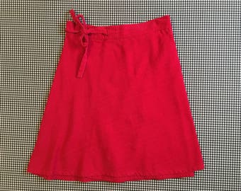 1970's, A-line, knee length, wrap skirt, in red, Women's size Small/Medium