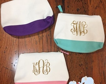 "Monogrammed canvas makeup bags. 9.5"" x 6.5"" available in mint, purple and pink"