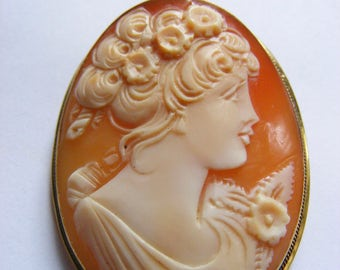 Victorian / Edwardian shell cameo pendant / brooch of a lady in rose gold metal