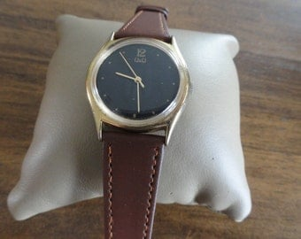 Vintage Wind Up Q&Q Watch with a Brown Leather Band