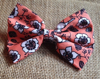 Peach hairbow with white flowers and birds