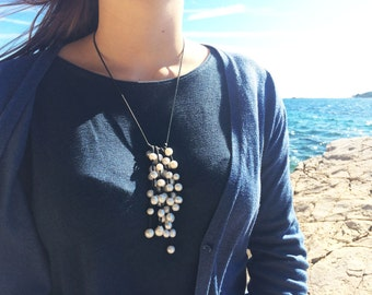 White freshwater cluster necklace on black leather