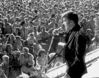 Elvis Presley ,  Elvis on stage in the late 1950's