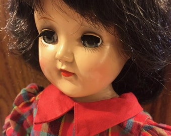Vintage Ideal Toni doll in original red dress