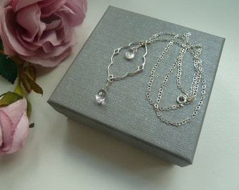 Sterling silver chain necklace with sterling silver diamond nimbus pendant, rose quartz and pink amethyst briolettes.