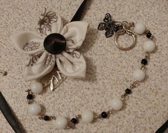 Black and white fabric flower necklace with beads and butterfly