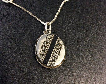 Victorian silver locket with black enamel ,on chain
