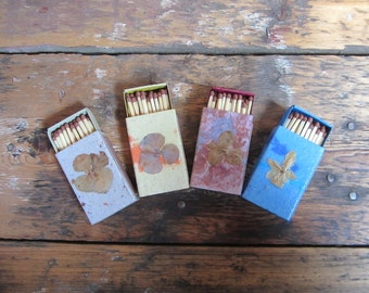 Decorative matchboxes of handmade paper, encrusted with raw nature material. Set of 4.(no.042)