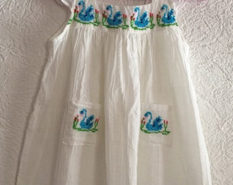 Beautiful child mexican dress hand embroidered with blue swans