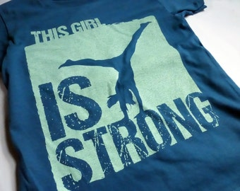 """WOMAN GYMNASTICS FITTED T-shirt """"Is Strong"""" Organic Short Sleeve Screen Printed Teal Blue Cotton Tee"""