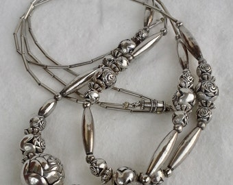 Vintage. sterling silver liquid and silver beads hand made necklace