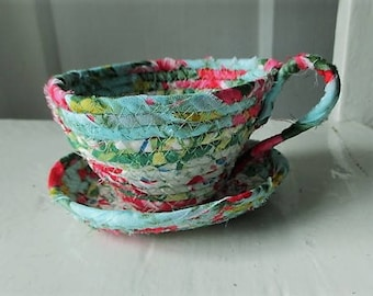 Coiled fabric tea cup and saucer.