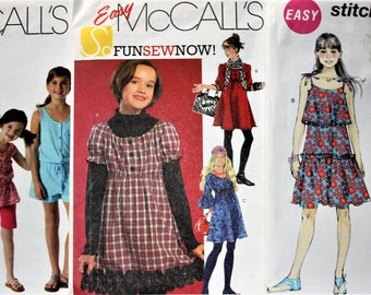 CLEARANCE SALE!   Lot of 9 GIRLS Uncut,Factory Folded Sewing Patterns. 4 sz 7,8,10,12,14.  2 sz 12-14.  2 sz 7-16. 1 sz 10-16. 7, Rated Easy