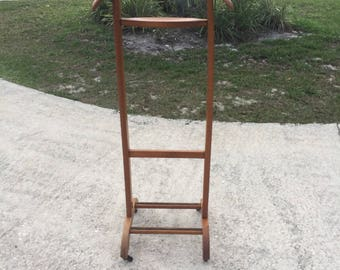 Mid-century Modern wooden suit butler by FRATELLI REGUITTI. Clothes rack stand.