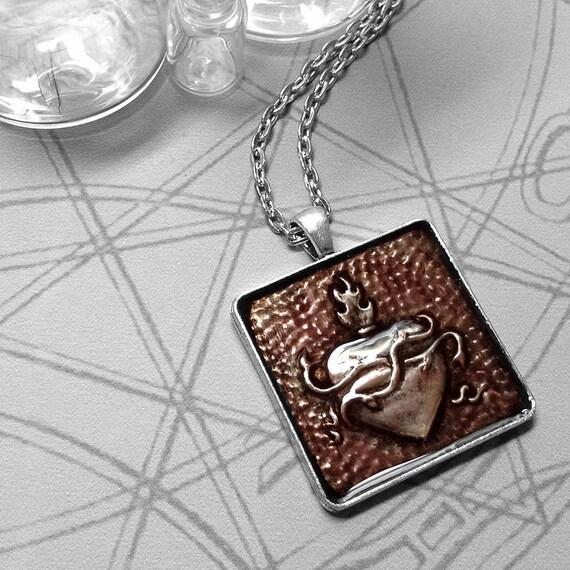 Plum Sacred Heart : hand embossed repoussé metal pendant necklace