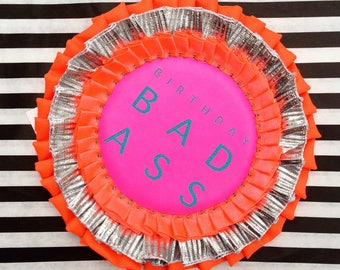 OVERSIZE BIRTHDAY BADGE in fluorescent pink, orange and silver. Handmade birthday rosette printed with 'birthday bad ass' Birthday girl pin.