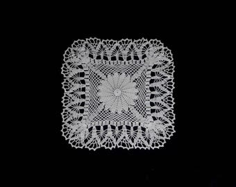 Vintage handmade crocheted doily centerpiece -- cream square doily with flower center and netted edge -- 12 inches / 30 cm