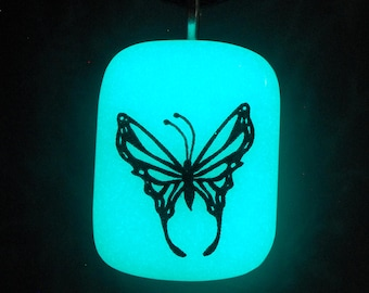 Glow in the dark glass Butterlfy pendant by Brent Graber fused up in our Oregon coast glass studio