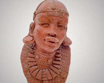 African porrait sculpture of a woman signed P Ochieng