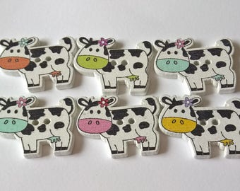 A Pack Of 20 Wooden Farmyard Cows