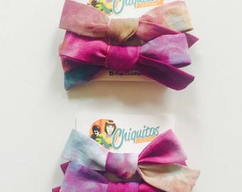 Pig Tails in Organic cotton hand dyed  pastel colors. Listing is for a set of two bows per card.