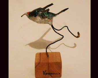 Bird papier-mache sculpture