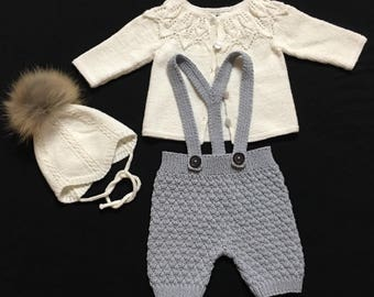 Baby hat with pompom and a romper