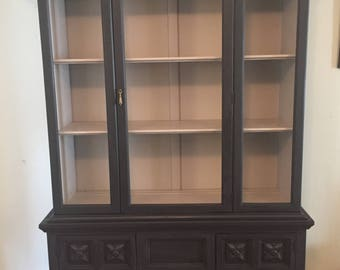 Distressed black china cabinet